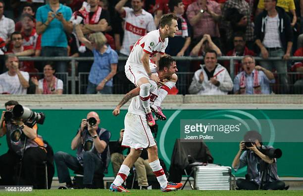 Martin Harnik of Stuttgart celebrates with his team mate Alexandru Maxim after scoring his team's second goal during the DFB Cup Semi Final match...