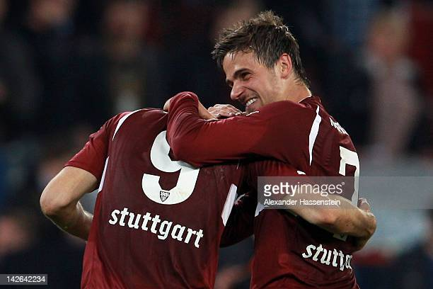 Martin Harnik of Stuttgart celebrates with his team mate Vedad Ibisevic after the Bundesliga match between FC Augsburg and VfB Stuttgart at SGL Arena...