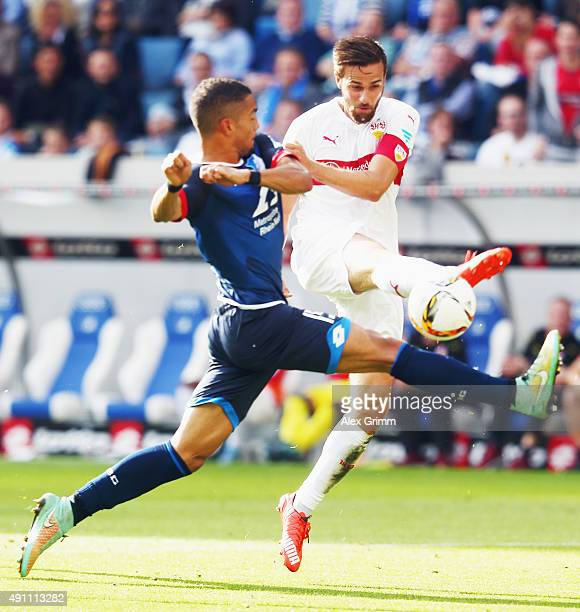 Martin Harnik of Stuttgart is challenged by Jeremy Toljan of Hoffenheim during the Bundesliga match between 1899 Hoffenheim and VfB Stuttgart at...
