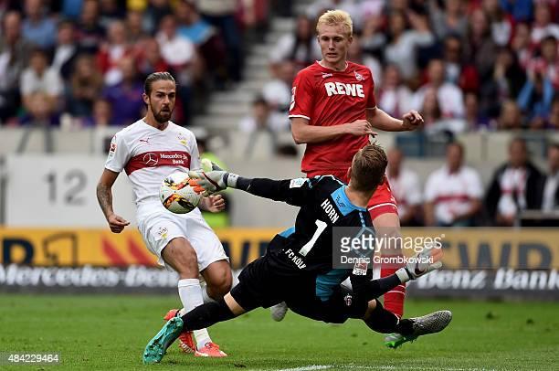 Martin Harnik of VfB Stuttgart is challenged by Frederik Sorensen of 1FC Koeln and goalkeeper Timo Horn of 1FC Koeln during the Bundesliga match...