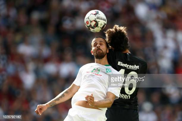 Martin Harnik of Werder Bremen and Lucas Torro of Eintracht Frankfurt battles for possession in the air during the Bundesliga match between Eintracht...