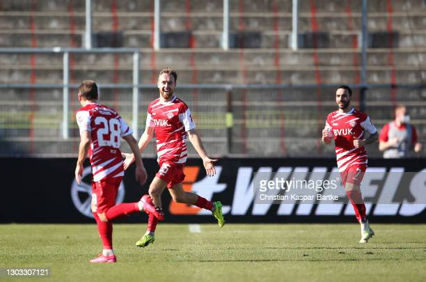 Martin Hasek of Wurzburger Kickers celebrates after scoring their side's first goal as team mate Mitja Lotric looks on during the Second Bundesliga...