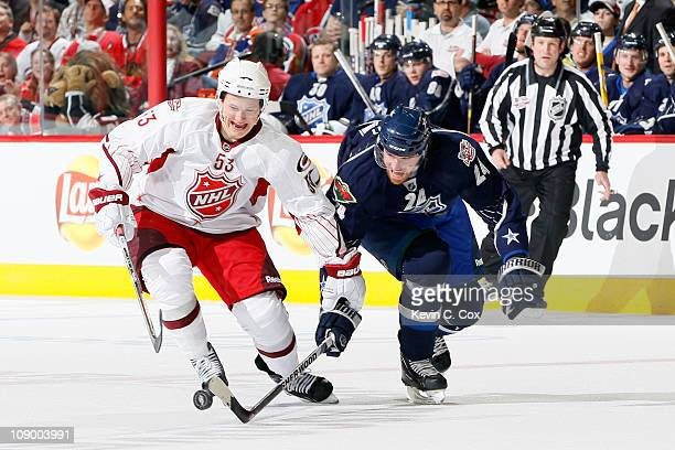 Martin Havlat of the Minnesota Wild and Team Lidstrom vies for the puck with Jeff Skinner of the Carolina Hurricanes and Team Staal in the 58th NHL...