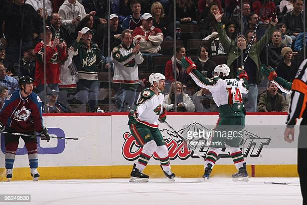 Martin Havlat of the Minnesota Wild celebrates the gamewinning goal with teammate Owen Nolan against the Colorado Avalanche at the Pepsi Center on...