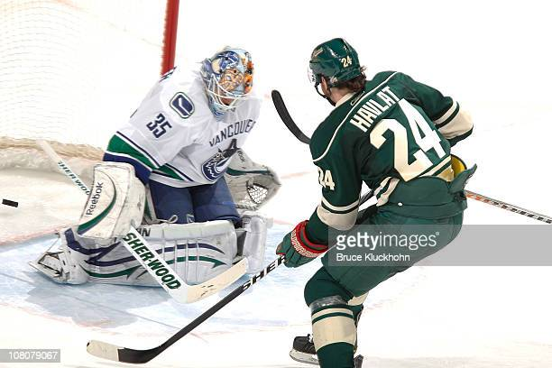 Martin Havlat of the Minnesota Wild scores a goal against Cory Schneider of the Vancouver Canucks during the game at Xcel Energy Center on January 16...