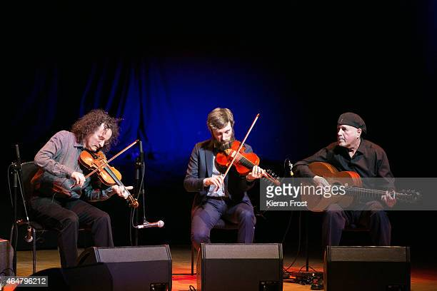 Martin Hayes, Caoimhin O Raghallaigh and Dennis Cahill of The Gloaming perform on stage at National Concert Hall on February 28, 2015 in Dublin,...