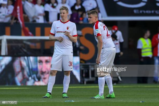 Martin Hinteregger of Augsburg and Alfred Finnbogason of Augsburg looks on during the Bundesliga match between FC Augsburg and Hamburger SV at WWK...