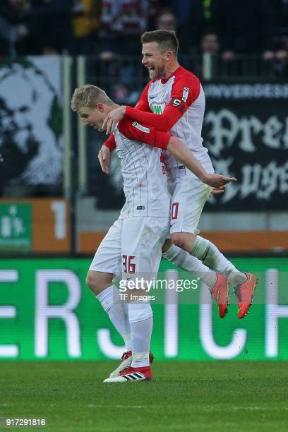 Martin Hinteregger of Augsburg and Daniel Baier of Augsburg celebrate their team`s goal during the Bundesliga match between FC Augsburg and Eintracht...