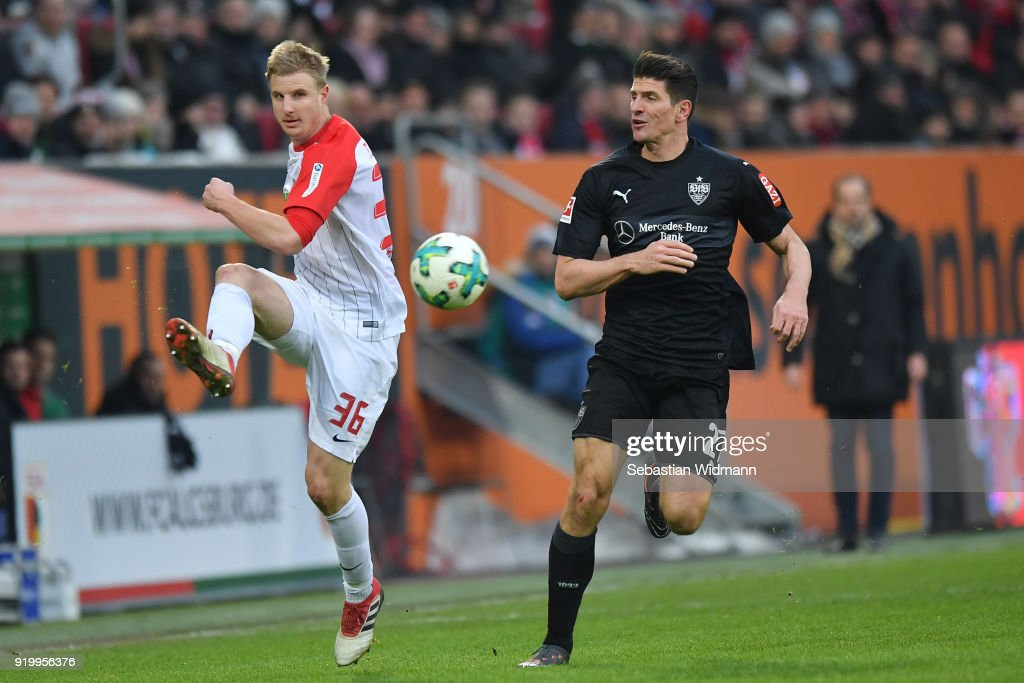 Martin Hinteregger of Augsburg and Mario Gomez of Stuttgart compete for the ball during the Bundesliga match between FC Augsburg and VfB Stuttgart at WWK-Arena on February 18, 2018 in Augsburg, Germany.