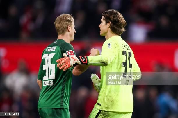 Martin Hinteregger of Augsburg and Marwin Hitz of Augsburg react after the Bundesliga match between 1 FC Koeln and FC Augsburg at RheinEnergieStadion...