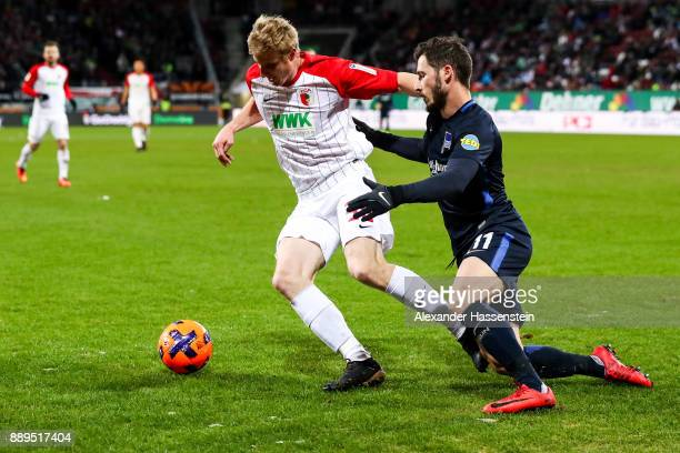 Martin Hinteregger of Augsburg and Matthew Leckie of Hertha Berlin battle for the ball during the Bundesliga match between FC Augsburg and Hertha BSC...