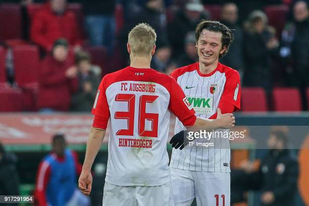 Martin Hinteregger of Augsburg and Michael Grogoritsch of Augsburg celebrate after winning the Bundesliga match between FC Augsburg and Eintracht...