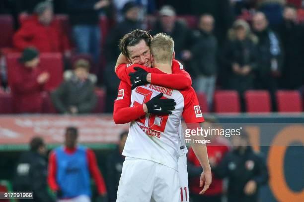 Martin Hinteregger of Augsburg and Michael Grogoritsch of Augsburg celebrate after winning the Bundesliga match between FC Augsburg and Eintracht...