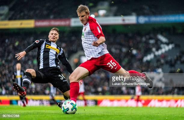 Martin Hinteregger of Augsburg and Nico Elvedi of Moenchengladbach in action during the Bundesliga match between Borussia Moenchengladbach and FC...
