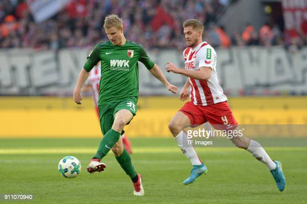 Martin Hinteregger of Augsburg and Simon Terodde of Koeln battle for the ball during the Bundesliga match between 1 FC Koeln and FC Augsburg at...