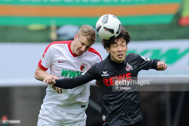 Martin Hinteregger of Augsburg and Yuya Osako of Colonge battle for the ball during the Bundesliga match between FC Augsburg and 1 FC Koeln at WWK...