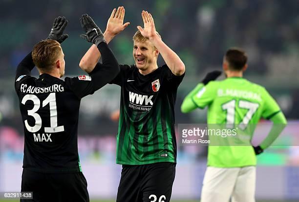 Martin Hinteregger of Augsburg celebrate with team mate Philipp Max after the Bundesliga match between VfL Wolfsburg and FC Augsburg at Volkswagen...