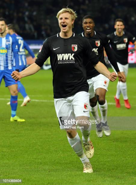 Martin Hinteregger of Augsburg celebrates after scoring his team's first goal during the Bundesliga match between Hertha BSC and FC Augsburg at...