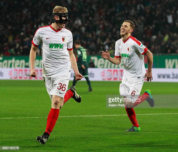 Martin Hinteregger of Augsburg celebrates with Jeffrey Gouweleeuw after scoring a goal during the Bundesliga match between FC Augsburg and Borussia...