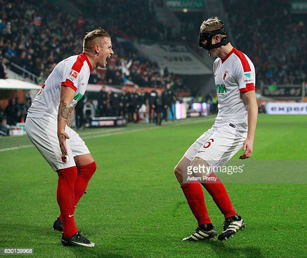 Martin Hinteregger of Augsburg celebrates with Jonathan Schmid after scoring a goal during the Bundesliga match between FC Augsburg and Borussia...