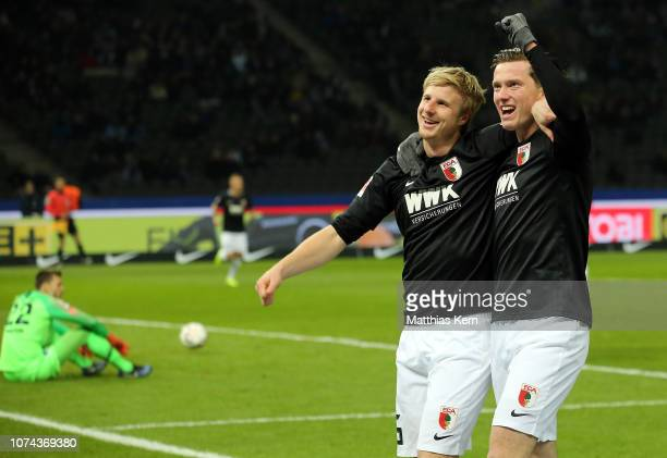 Martin Hinteregger of Augsburg celebrates with teammates after scoring his team's first goal during the Bundesliga match between Hertha BSC and FC...