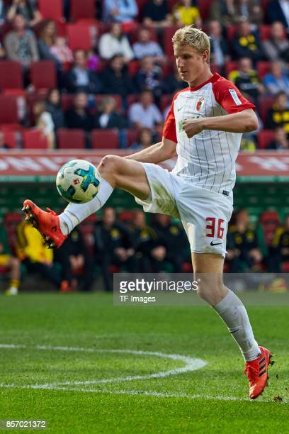 Martin Hinteregger of Augsburg controls the ball during the Bundesliga match between FC Augsburg and Borussia Dortmund at WWKArena on September 30...