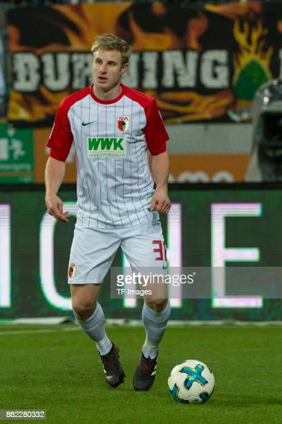 Martin Hinteregger of Augsburg controls the ball during the Bundesliga match between FC Augsburg and VfL Wolfsburg at WWKArena on November 25 2017 in...