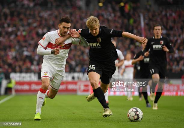 Martin Hinteregger of Augsburg is challenged by Anastasios Donis of VfB Stuttgart during the Bundesliga match between VfB Stuttgart and FC Augsburg...