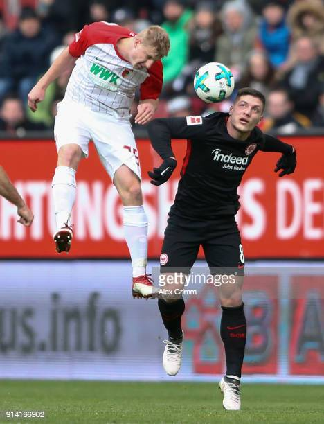 Martin Hinteregger of Augsburg jumps for a header with Luka Jovic of Frankfurt during the Bundesliga match between FC Augsburg and Eintracht...