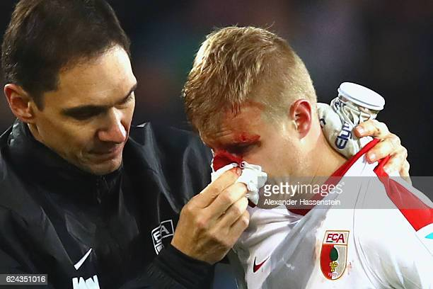 Martin Hinteregger of Augsburg leaves the field after geting injured during the Bundesliga match between FC Augsburg and Hertha BSC at WWK Arena on...