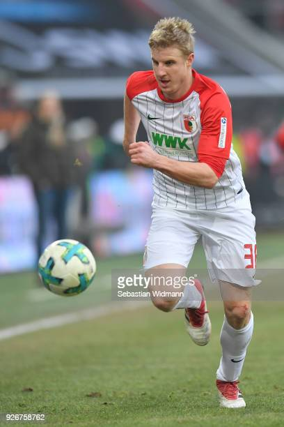 Martin Hinteregger of Augsburg runs after the ball during the Bundesliga match between FC Augsburg and TSG 1899 Hoffenheim at WWKArena on March 3...