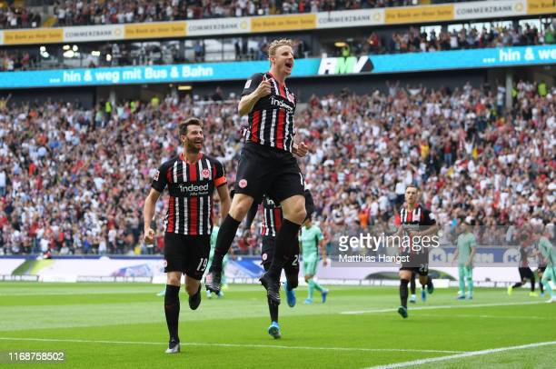 Martin Hinteregger of Eintracht Frankfurt celebrates as he scores his team's first goal during the Bundesliga match between Eintracht Frankfurt and...