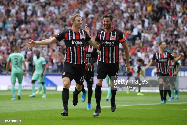 Martin Hinteregger of Eintracht Frankfurt celebrates as he scores his team's first goal with David Abraham during the Bundesliga match between...