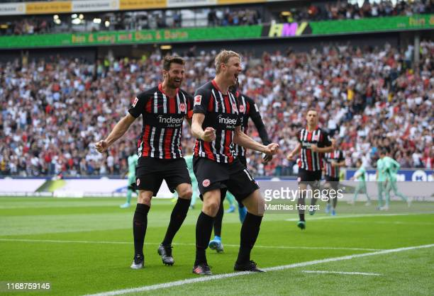 Martin Hinteregger of Eintracht Frankfurt celebrates as he scores his team's first goal with team mates during the Bundesliga match between Eintracht...