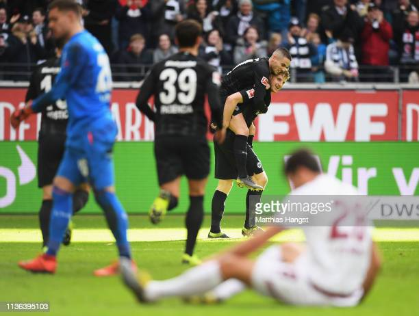 Martin Hinteregger of Eintracht Frankfurt celebrates scoring his teams first goal of the game with team mates during the Bundesliga match between...