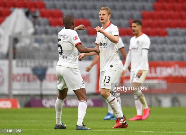 Martin Hinteregger of Eintracht Frankfurt celebrates with Gelson Fernandes after scoring his team's second goal during the Bundesliga match between...