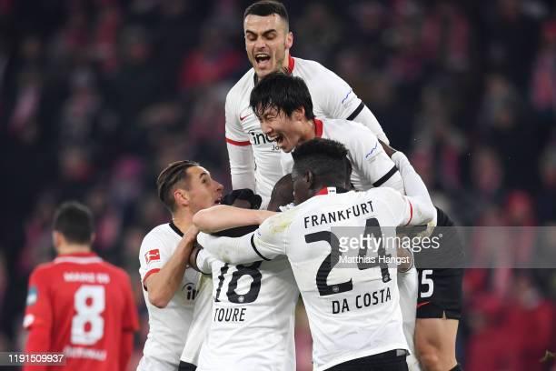 Martin Hinteregger of Eintracht Frankfurt celebrates with teammates after scoring his team's first goal during the Bundesliga match between 1. FSV...