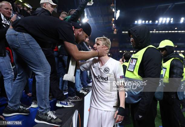 Martin Hinteregger of Eintracht Frankfurt is embraced by a fan after the UEFA Europa League Semi Final Second Leg match between Chelsea and Eintracht...