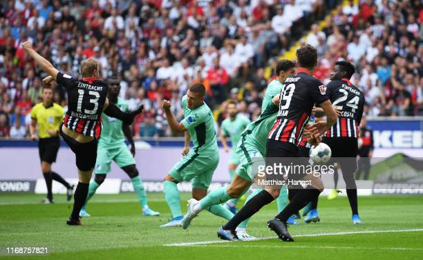 Martin Hinteregger of Eintracht Frankfurt scores his team's first goal during the Bundesliga match between Eintracht Frankfurt and TSG 1899...