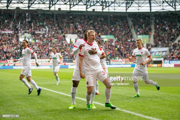 Martin Hinteregger of FC Augsburg celebrate with team mates after he scores the first goal during the Bundesliga match between FC Augsburg and 1 FC...