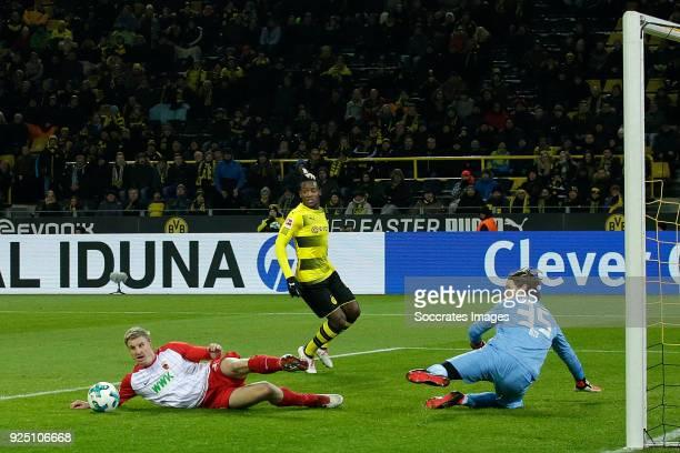 Martin Hinteregger of FC Augsburg Michy Batshuayi of Borussia Dortmund Marwin Hitz of FC Augsburg during the German Bundesliga match between Borussia...