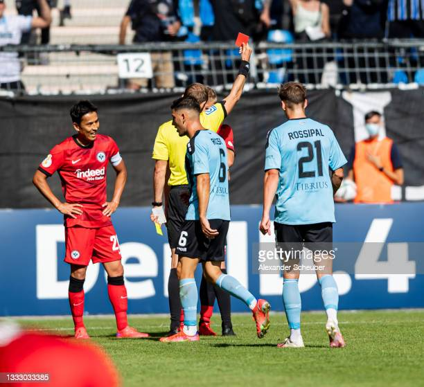 Martin Hinteregger of Frankfurt gets the red card during the DFB Cup first round match between Waldhof Mannheim and Eintracht Frankfurt at...