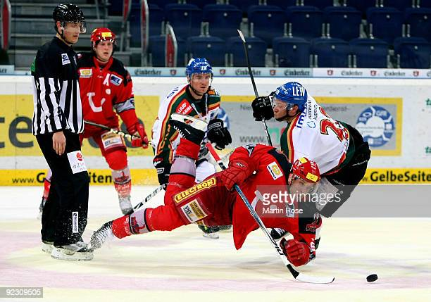 Martin Hlinka of Hannover and Thomas Joerg of Augsburg battle for the puck during the DEL match between Hannover Scorpions and Augsburg Panther at...