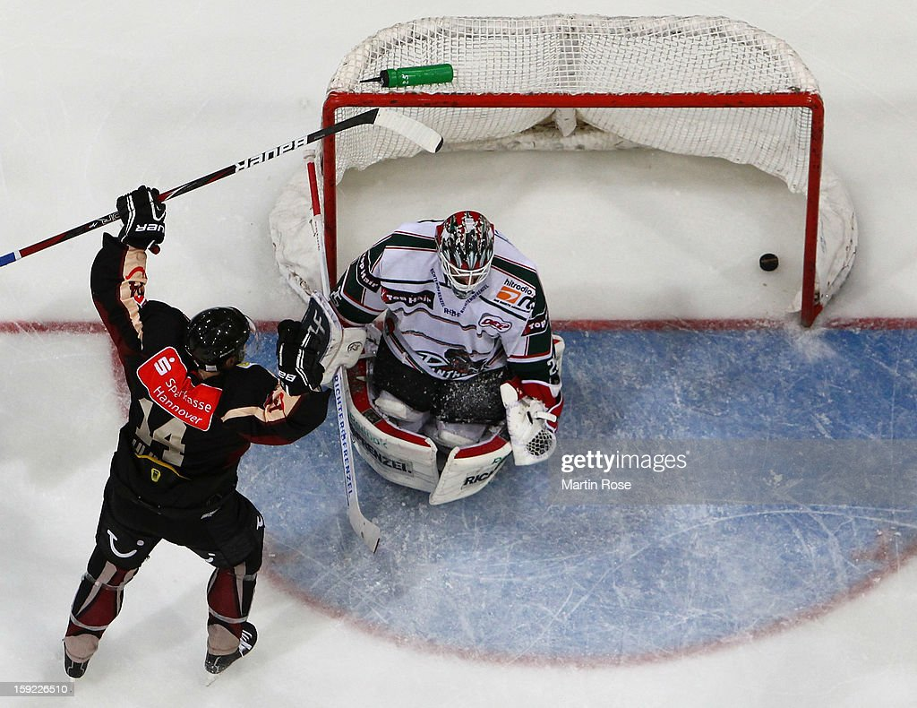 Martin Hlinka (L) of Hannover celebrates his team's 1st goal during the DEL match between Hannover Scorpions and Augsburger Panther at TUI Arena at TUI Arena on January 9, 2013 in Hanover, Germany.