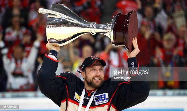 Martin Hlinka of Hannover celebrates with the trophy after winning the DEL play off final match between Hannover Scorpions and Augsburger Panther at...