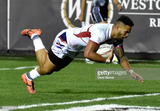 Martin Iosefo of the United States dives in for a try against Australia during the USA Sevens Rugby tournament at Sam Boyd Stadium on March 2, 2018...