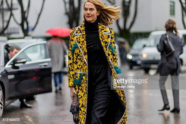 Martin is wearing a yellow coat seen outside Giorgio Armani during Milan Fashion Week Fall/Winter 2016/17 on February 29 in Milan Italy