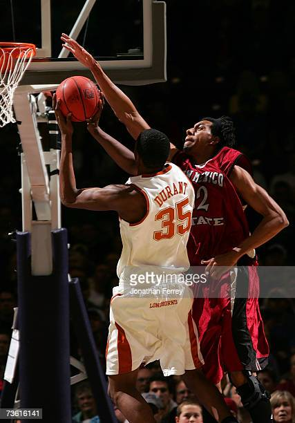 Martin Iti of the New Mexico State Aggies goes up for the block on a shot attempt by Kevin Durant of the Texas Longhorns during the first round of...