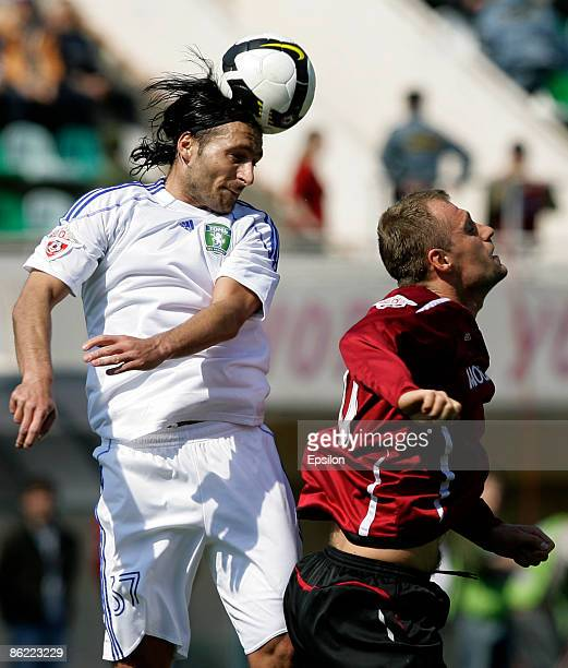 Martin Jakubko of FC Moscow battles for the ball with Dorde Jokic of FC Tom Tomsk during the Russian Football League Championship match between FC...