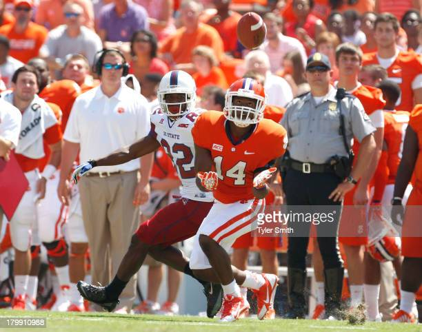 Martin Jenkins of the Clemson Tigers intercepts a pass intended for Caleb Davis of the South Carolina State Bulldogs during the game at Memorial...